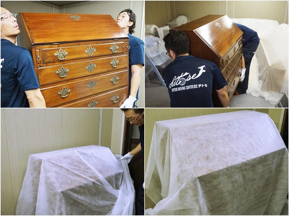 アンティーク家具のプレミアム保管を行うスタッフ