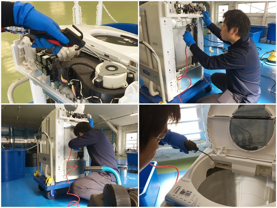 洗濯機内部のホコリをエアポンプで除去するスタッフ