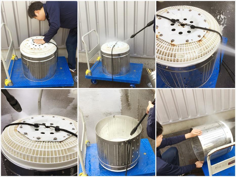 洗濯槽を高圧洗浄機で洗浄するスタッフ