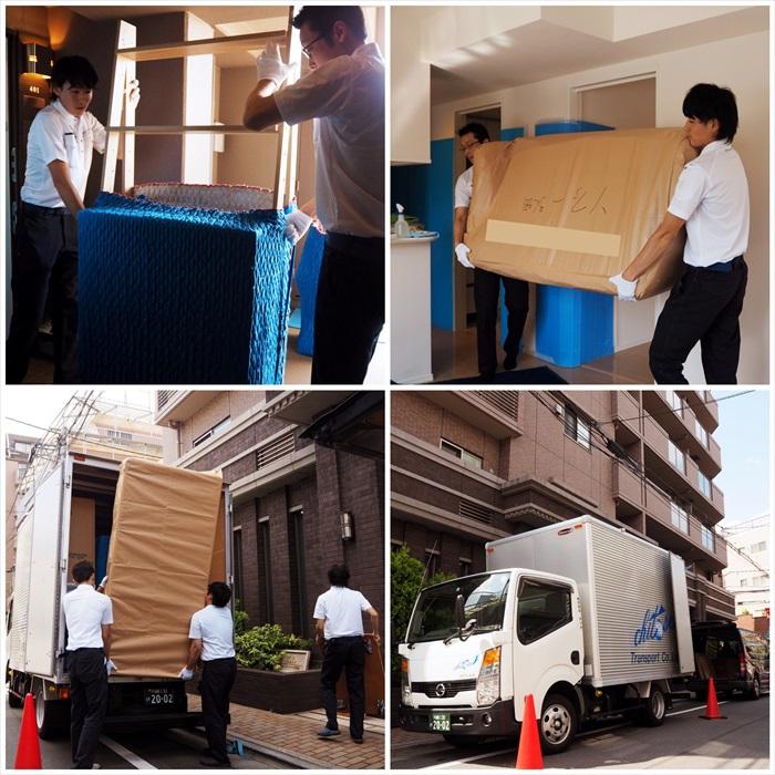 荷物をトラックに運び込むスタッフ
