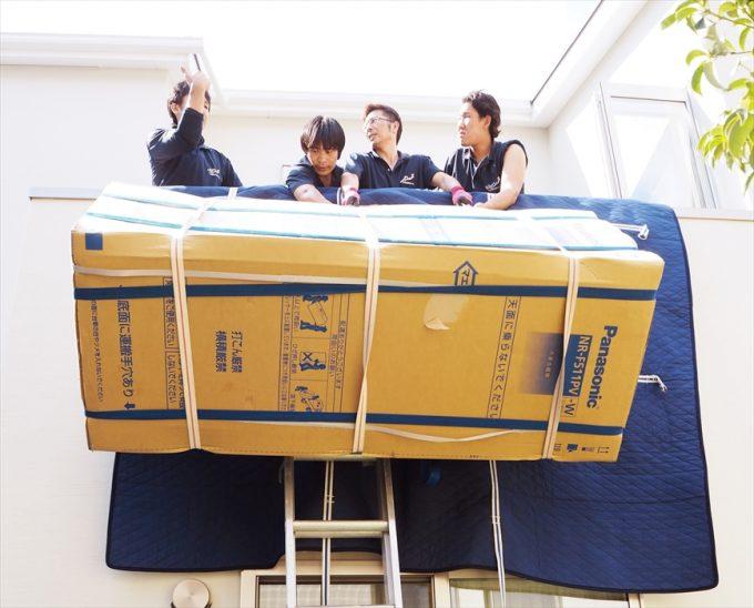冷蔵庫の手吊り作業.6